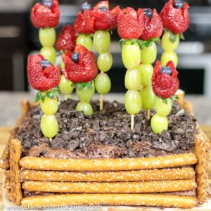 Mother's Day Dessert Idea: chocolate cake topped with strawberry roses and decorated to look like a garden.
