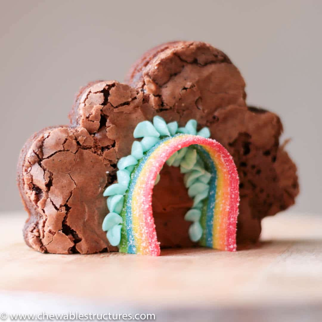 cloud-shaped brownie decorated with Airheads rainbow candy and blue buttercream frosting
