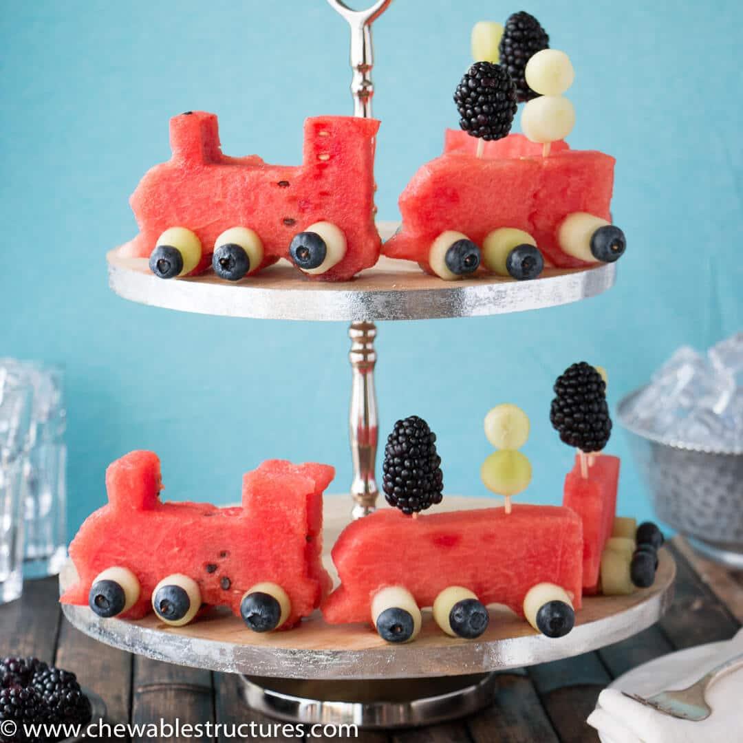 two levels of a watermelon shaped like a train