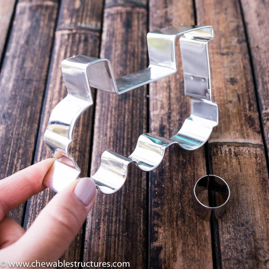 train cookie cutter next to a small circle cookie cutter