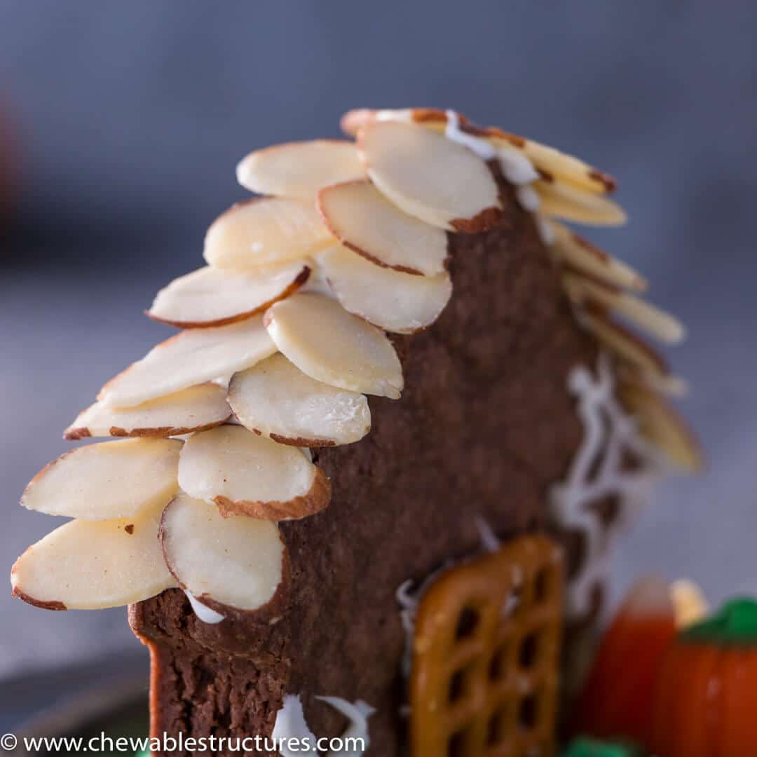 Shaved almond roof shingles on top of a chocolate brownie house