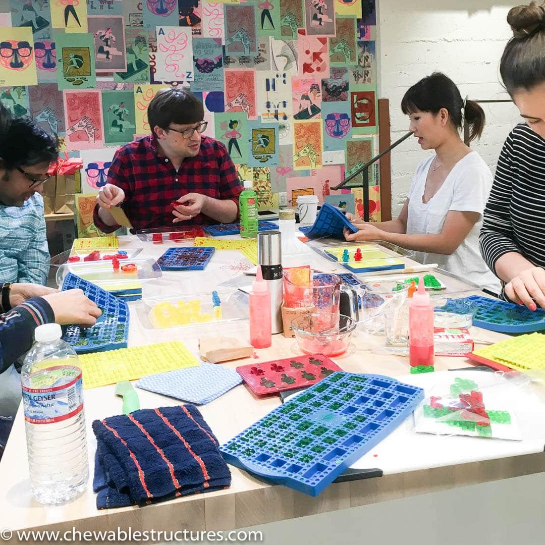 Students building edible food art.