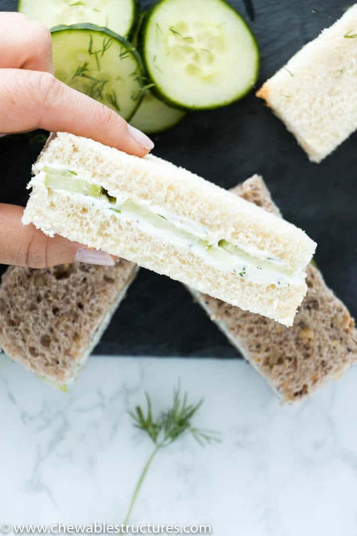 Cucumber sandwiches made of fresh bread, cream cheese, English cucumber slices, fresh chives, and fresh dill.