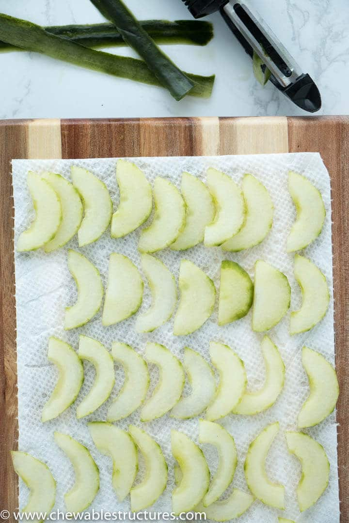 Top view of cucumber slices drying on paper towel