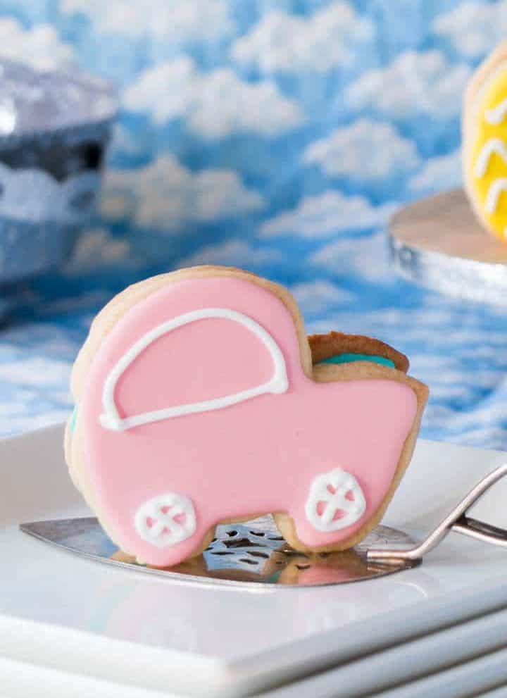 3-D sugar cookie shaped like a baby carriage
