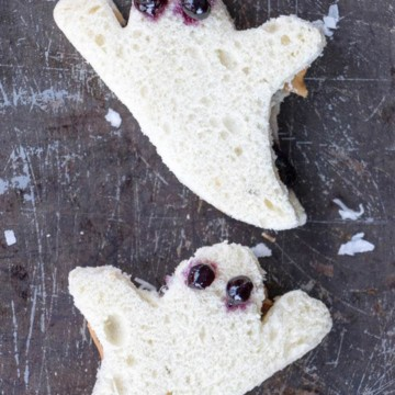 Halloween sandwiches shaped like ghosts made of peanut butter and jelly