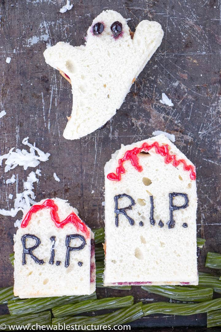ghost and tombstone-shaped peanut butter sandwiches with green apple licorice as grass