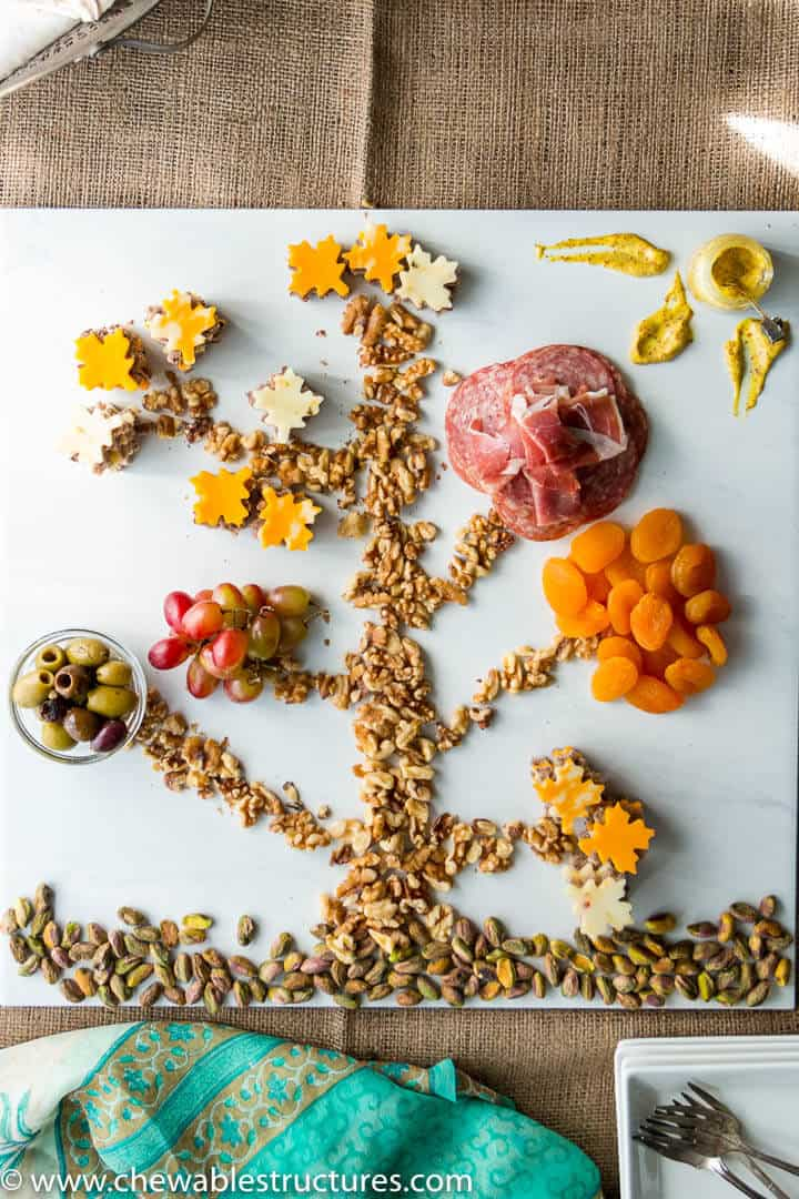 A cheese and charcuterie board that look like a tree.