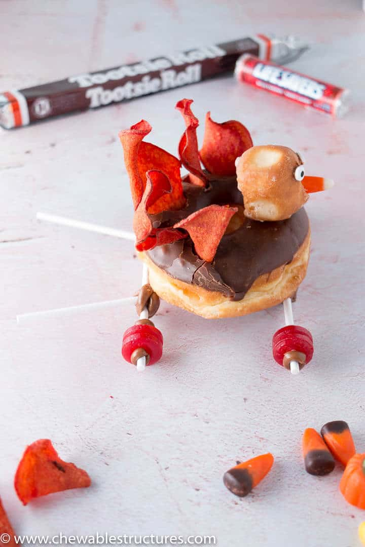side view of a donut turkey on a car frame made of Life Savers and Tootsie Roll