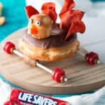 Thanksgiving Treats using chocolate turkey donut on a car frame with Life Savers tires